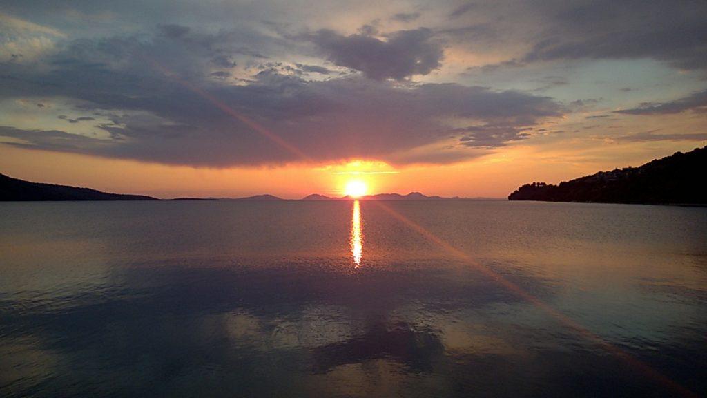 Sailing sunset greece